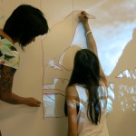 Di-ay Battad demonstrates another art installation exercise which consisted of tracing a number of projected images onto the wall to create a single drawing.