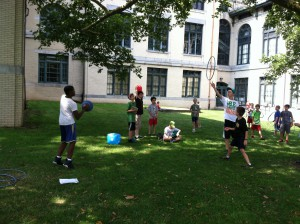 Campers playtest each others' games outside on the Carnegie Mellon University campus.