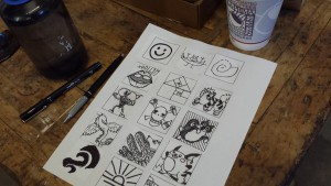 Designs are transferred onto metal sheets as a raised impression from which an ink and paper print is made.
