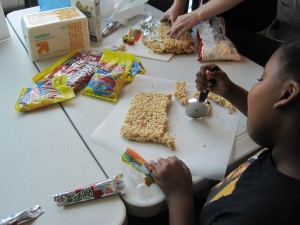 Teens at the candy sushi-making activity