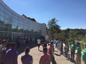 The teens of the summit take part in a team-building exercise outside the Special Events Hall.
