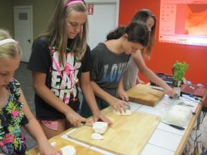 Chopping cheese curd to make mozzarella