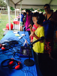 Two young students experiment with radio broadcasting.