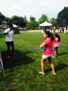 Kids enjoy hula hooping in their final moments of the summer.