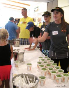 "Tropical Smoothie Cafe members serving up ""Island Green"" smoothies."